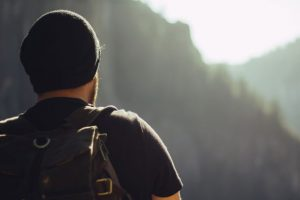 A healthy diet and exercise can prevent Type 2 Diabetes. Image shows a man with a backpack on a hike.