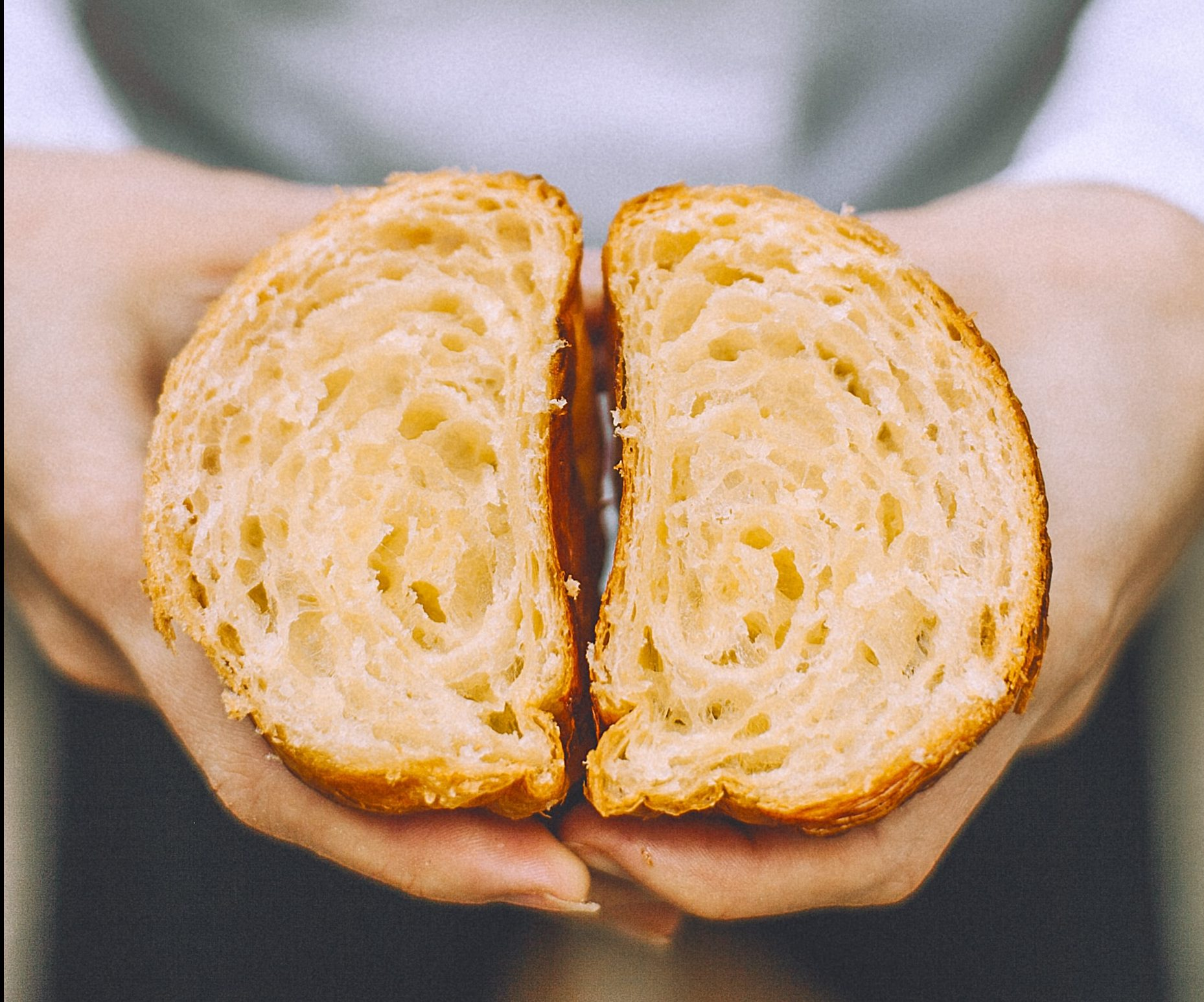 Image shows a close up view of a slice of bread. There are holes in the bread created by bubble of carbon dioxide.